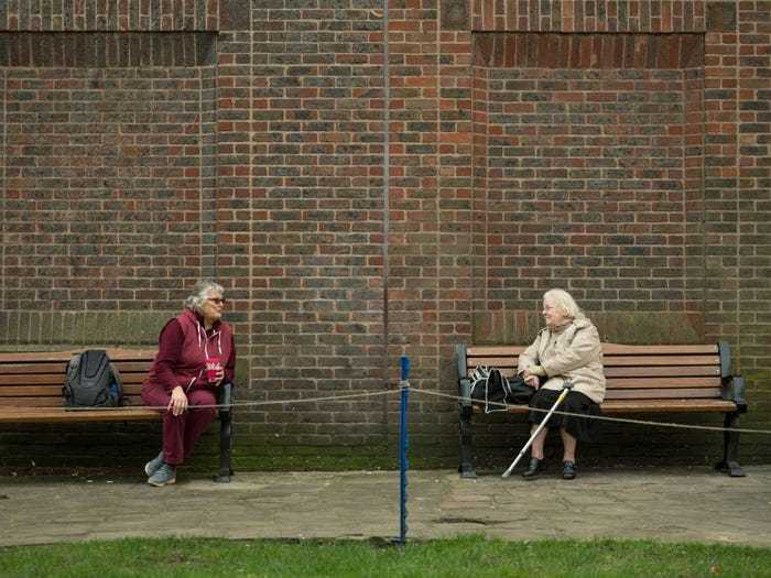 Social distancing photo gallery - elderly on benches speaking from a distance in York