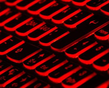 Coronavirus and Phishing - black keyboard with red backlights