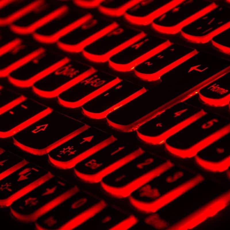 Coronavirus and Phishing - black keyboard with red backlights