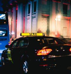 coronavirus and taxis - dublin taxi behind bus on dame street