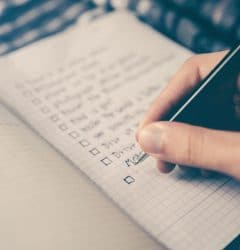 rank math tutorials - hand writing on a notebook