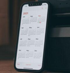 trading online voucher august 2021 mobile phone showing 2021 calendar